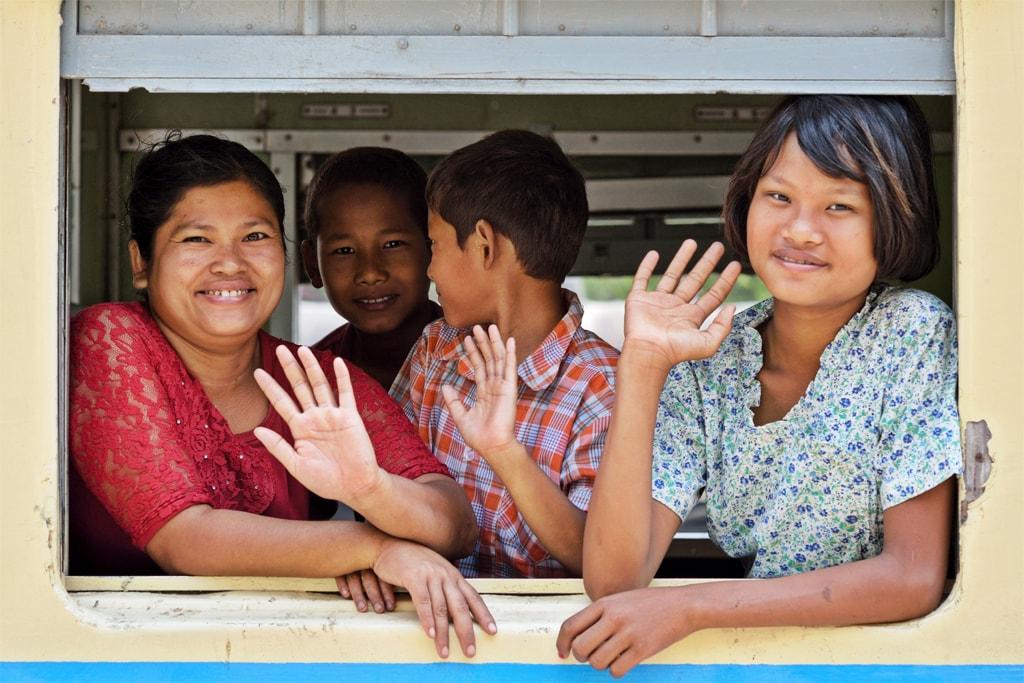 Burmese-People-Waving-from-a-Train-Window
