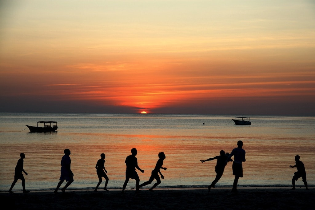 Sunset football on the beach