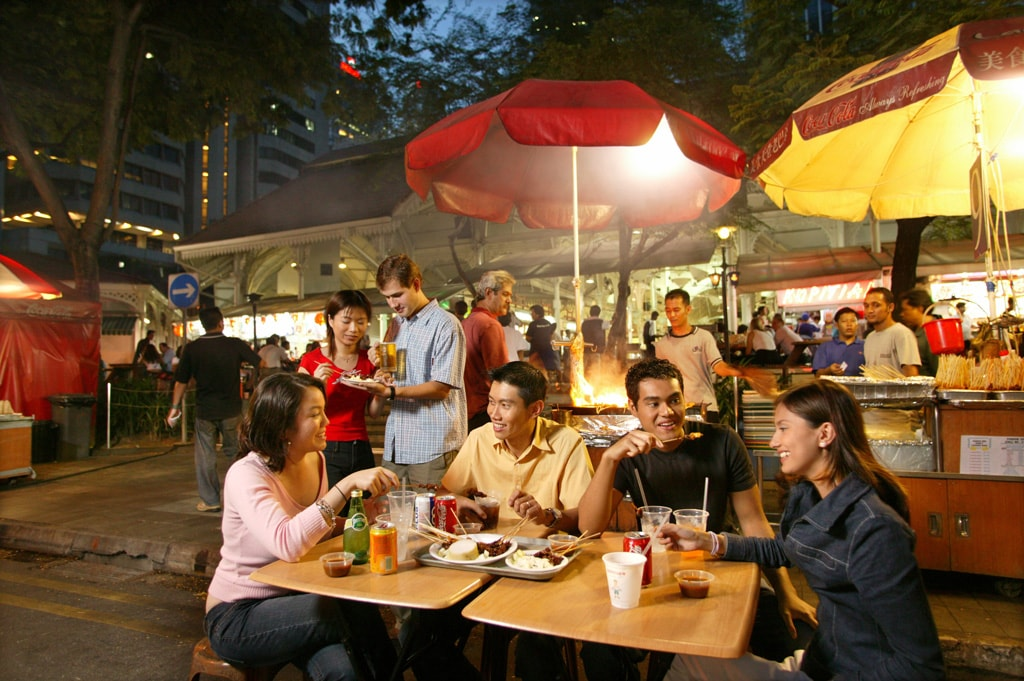 People eating satay at Lau Pa Sat | Courtesy Singapore Tourism Board