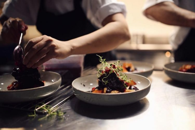 Preparing one of the dishes | Courtesy of Grådi