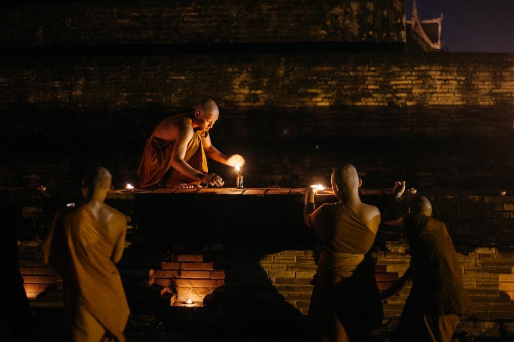 Monks light candles on an ancient 'stupa' | Gioia Emidi / © Culture Trip