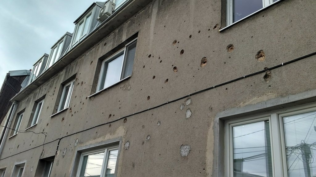 Visible holes from the war on apartment blocks | © Sam Bedford