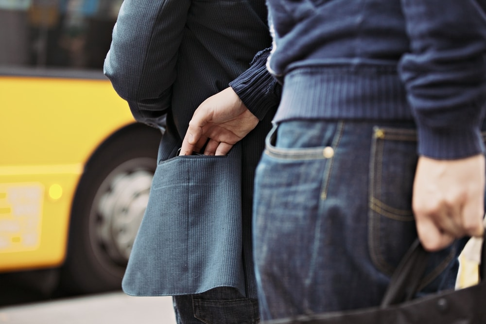 Pickpocket in the act   ©Jacob Lund/Shutterstock