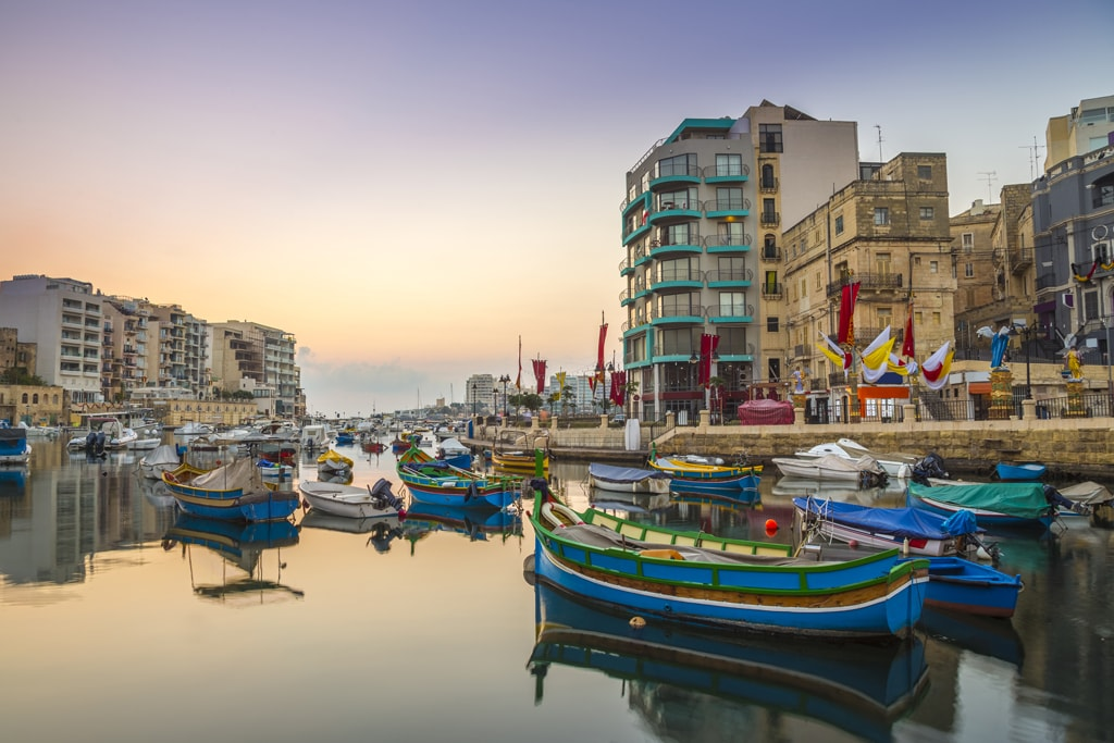 Traditional colourful 'luzzu' fishing boats, Spinola Bay | ©  Zoltan Gabor / Shutterstock