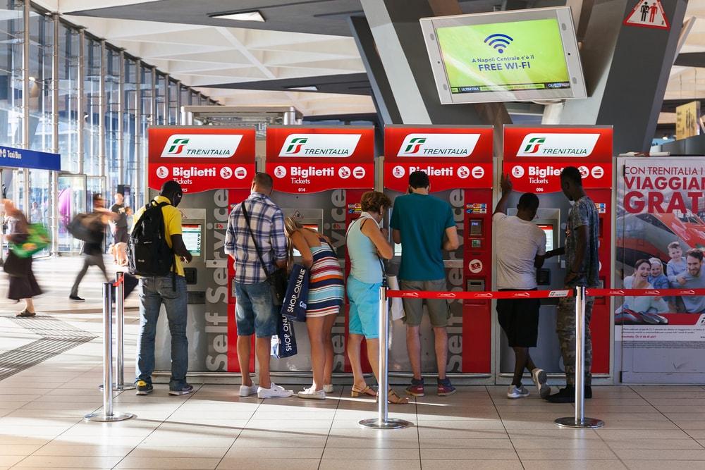 Travellers buying train tickets in Naples, Italy   ©Polifoto/Shutterstock