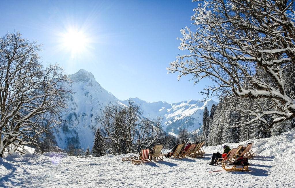 Sunbathing in snow. Germany, Bavaria, Allgau | © Drepicter/Shutterstock