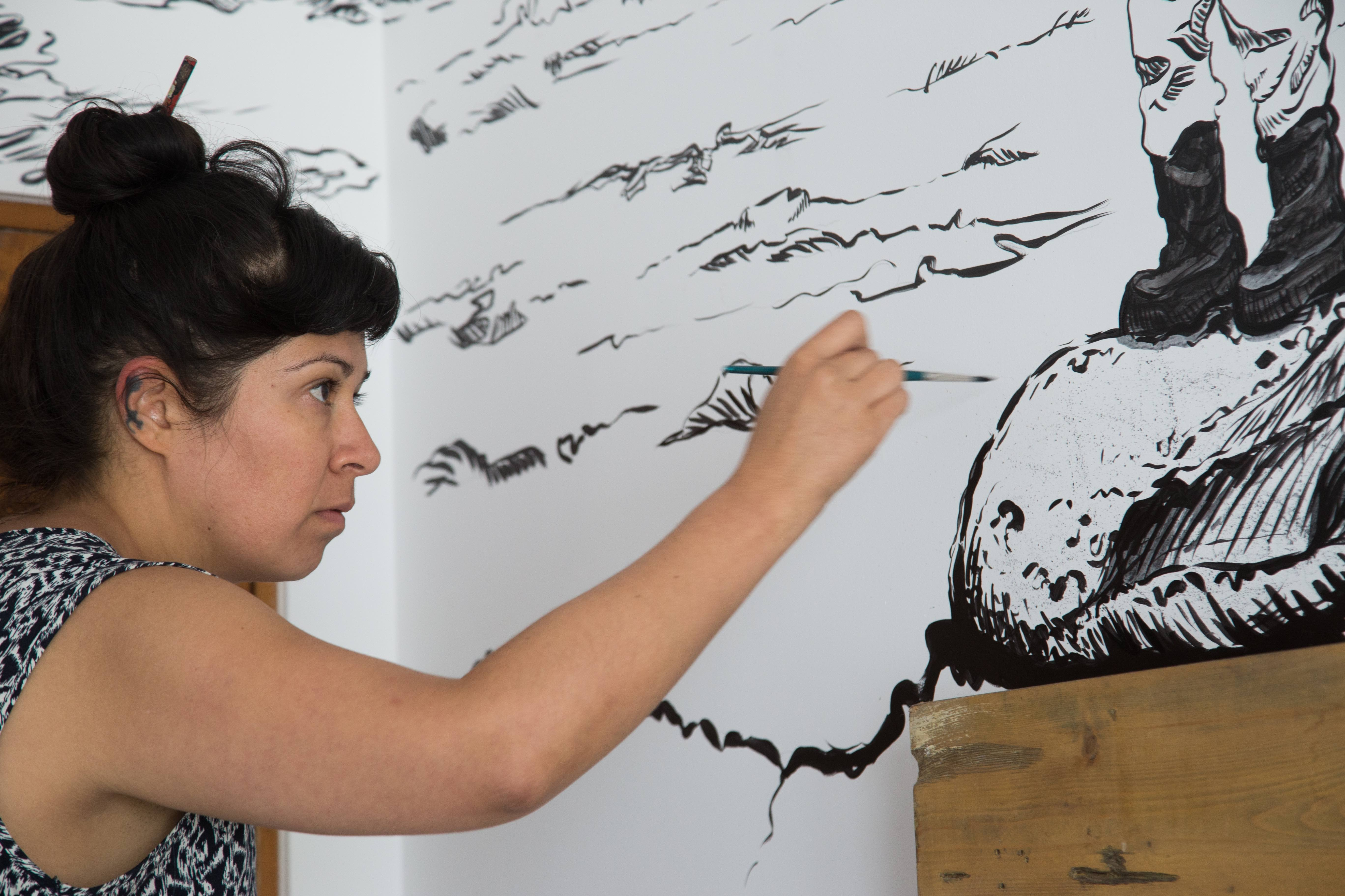 Visual and installation artist Soma, painting her room | © El Ganzo