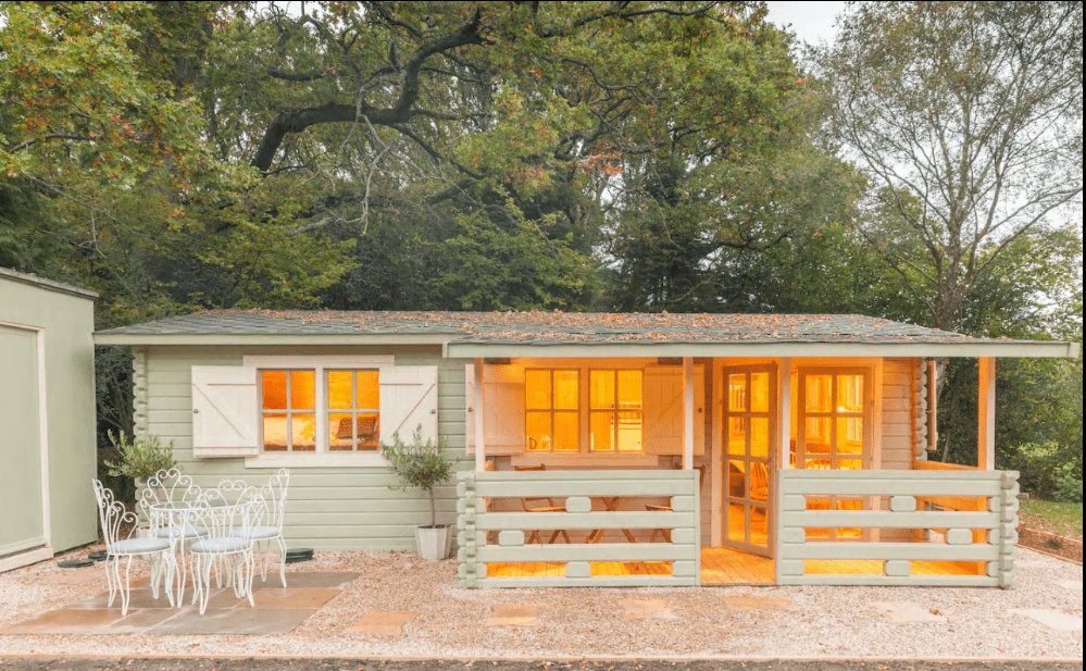 1. Frontage of the log cabin showing veranda and patio area Courtesy of AirBnb
