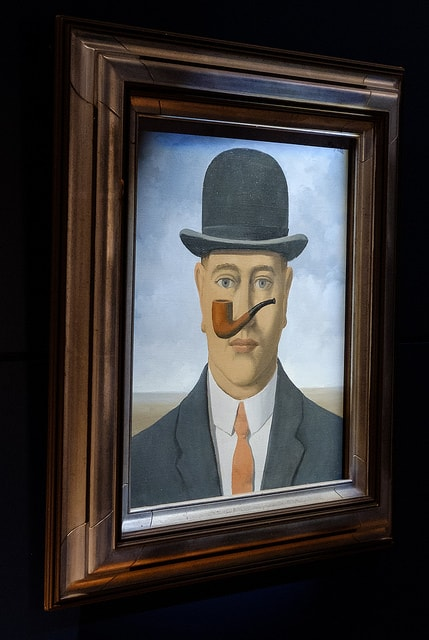 "Rene Magritte painting | <a href=""https://www.flickr.com/photos/allan_harris/35214936013/in/photolist-VDPKBc-WTrtYn-b4oAWB-93SF6H-5mbmYx-Wi28AL-hB9aj-cqWsub-VDPGk2-hB9aa-hB998-39ET4v-cqWsH7-Wi29qG-WPL8WL-b4orgn-9VmYff-nrtiqW-6MMU9X-bacMsK-6uxcFN-b4oxav-q2zGaZ-b4osn6-bTz4EZ-hB98R-8M5NGF-aihEew-WTrtnn-hB9a5-hB99S-hB99h-bt45aS-VBfJNN-WPKU7w-hB9aA-Wi2nU5-k7VssE-WPL3W5-hB9a1-WCj1ef-9RaxRF-CZV5i-bacMpv-9Ae3JG-Mdvg5-WrUrcd-mxadWb-5HUmVB-Au3cM7"" target=""_blank"" rel=""noopener"">© alh1 / Flickr</a>"