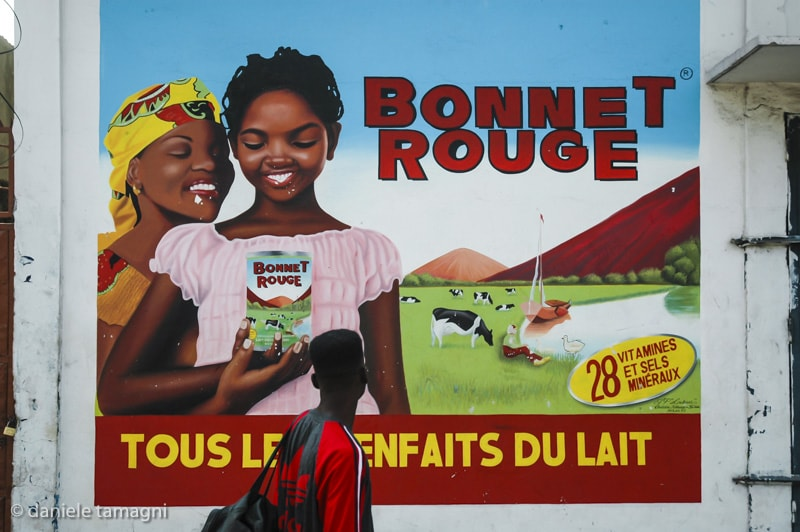 Daniele Tamagni - BONNET ROUGE from the series AFRICAN BRANDS WALLS, Brazzaville ( Congo) 2006