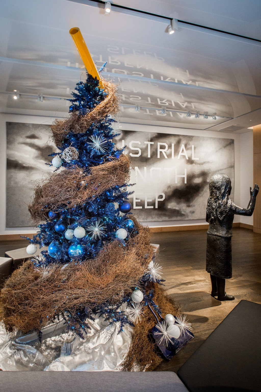 The Claes Oldenburg tree in front of Ed Ruscha's <em>Industrial Strength Sleep</em> (2007) | Courtesy of the ART, a hotel.