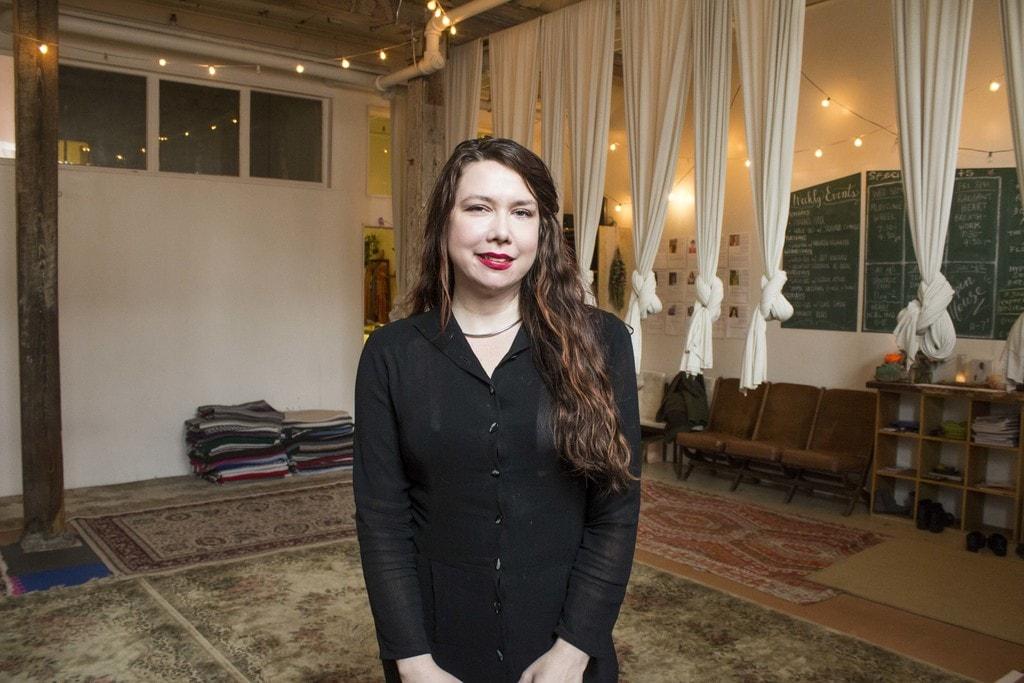 Shauna Cummins stands inside the front room of Maha Rose