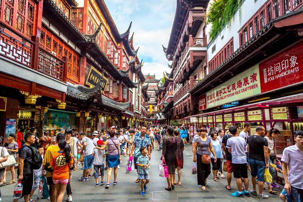 Locals and tourists enjoying a warm summer's day in downtown Shanghai, China | © LMspencer/Shutterstock