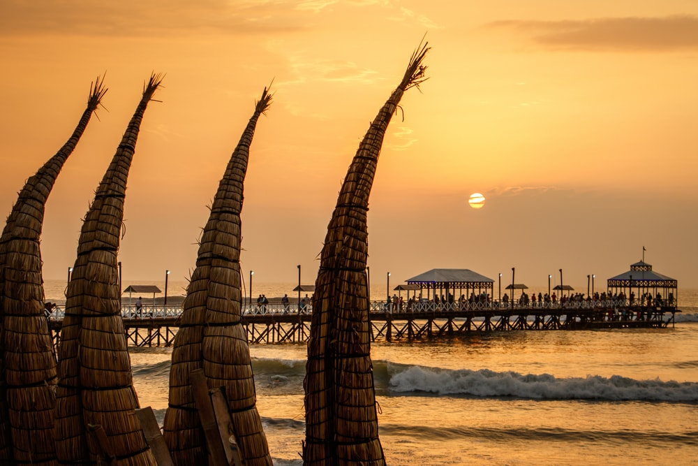 The sunset with traditional boat craft at Huanchaco town, near Trujillo, Peru | © Ludmila Ruzickova/Shutterstock