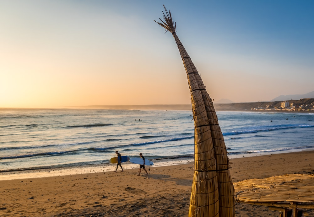 Huanchaco Beach and the traditional reed boats, Peru | © Diego Grandi/Shutterstock