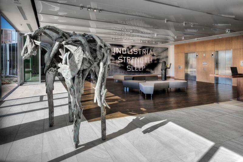 Deborah Butterfield's<em>Otter</em> (2014) stands in front of Ed Ruscha's<em>Industrial Strength Sleep</em> (2007) | Courtesy of The ART Hotel.