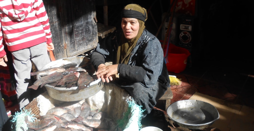 Woman selling fish at the market | © Mariam Ghorab