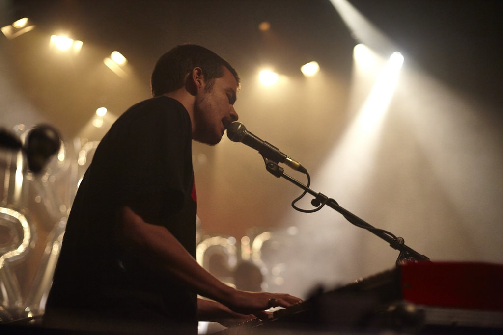 "Rex Orange County | <a href=""https://www.flickr.com/photos/villageunderground/36950477440/in/photolist-YibSK7-YibRBf-YFCQoF-YBrDjN-XEu2V2-YibFiQ-XEu4hR-YibPM3-YUhjwH-YUhhyp-XEt5uH-XCapPU-YFBAVa-YUiR9H-YBre6h-XEu19r-YibMqj-XCasYj-YBrg2b-YUhfb8"" target=""_blank"" rel=""noopener"">Photo by Wyatt Dixon © villunderlondon/Flickr</a>"