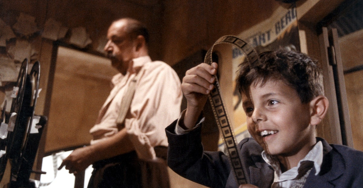 Philippe Noiret and Salvatore Cascio in <em>Cinema Paradiso</em>   © Miramax Films