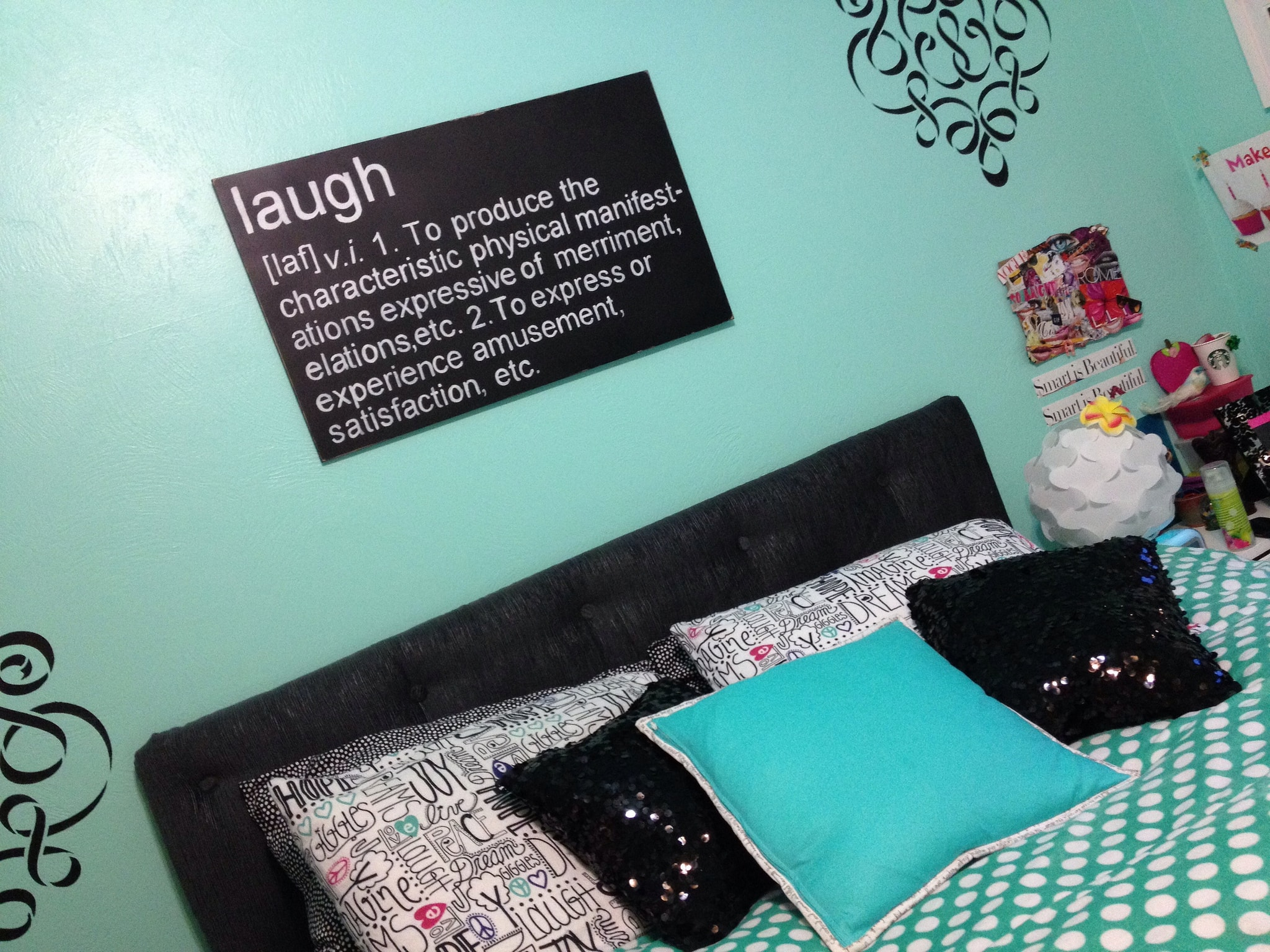 """Sequin pillows and a """"Laugh"""" sign