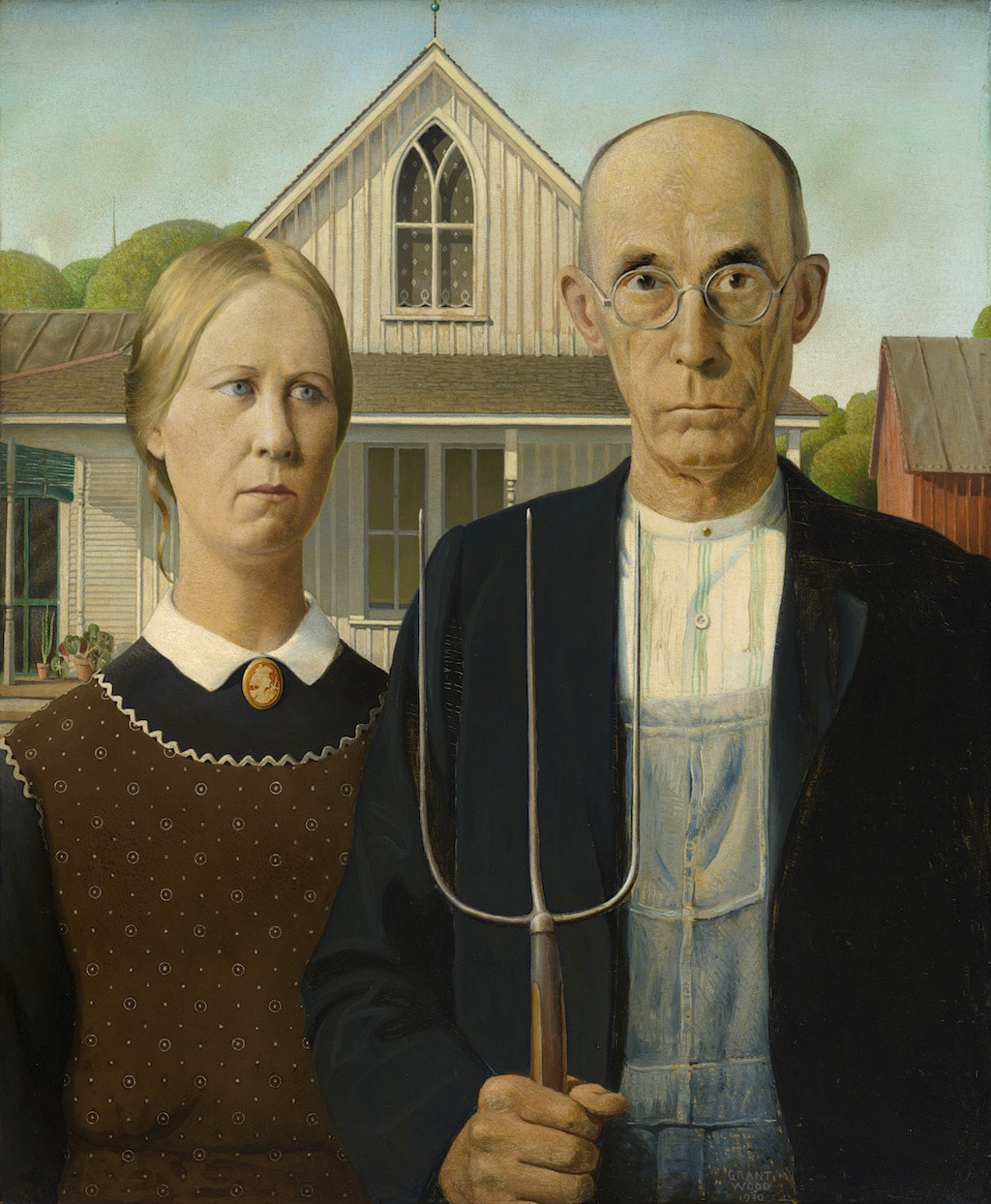 Grant Wood, <em>American Gothic</em>, 1930. © Figge Art Museum, successors to the Estate of Nan Wood Graham/Licensed by VAGA, New York, NY. Photograph courtesy of Art Institute of Chicago/Art Resource, NY