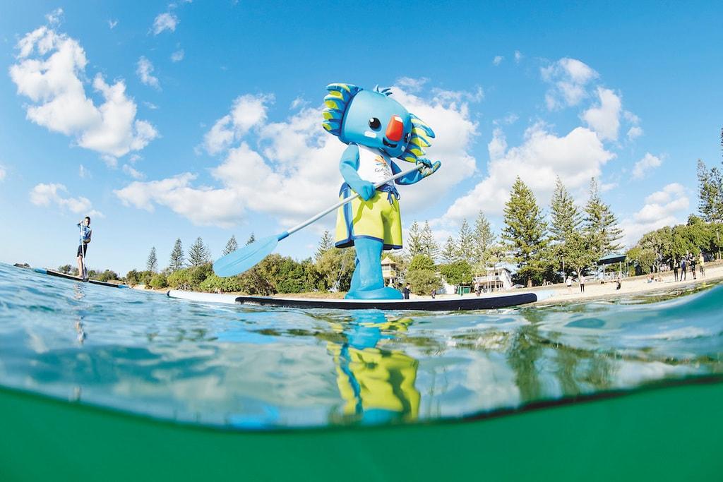Borobi the mascot paddleboards along Tallebudgera Creek   © TEQ