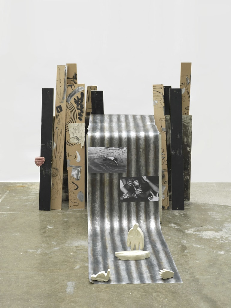 Caitlin Hazell Growing Up With Corrugation, 2017 Wood, monoprint, false corrugated iron, stone carvings and photographs with optional live performance component, 67 x 117 x 300 cm