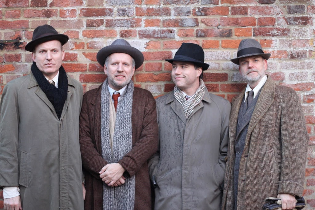 Norbert Meyn (second from left) in costume for the filming of the documentary