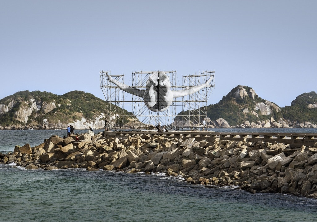 Installation by French Street artist JR of olympic swimmer diving into sea in Brazil