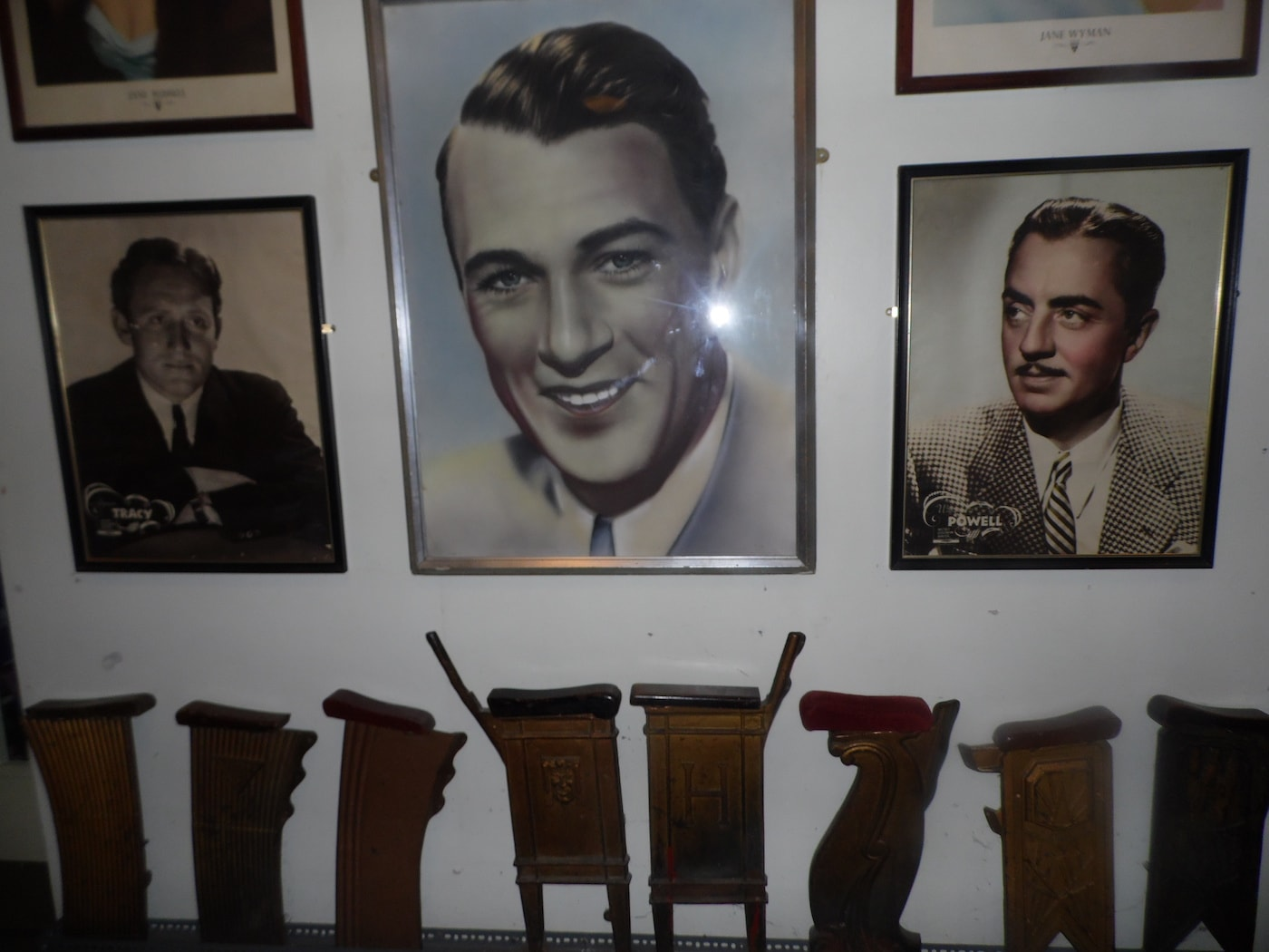 Vintage images of Spencer Tracy, Gary Cooper, and William Powell above man-made wooden cinema seats | © Lynsey Ford/Culture Trip