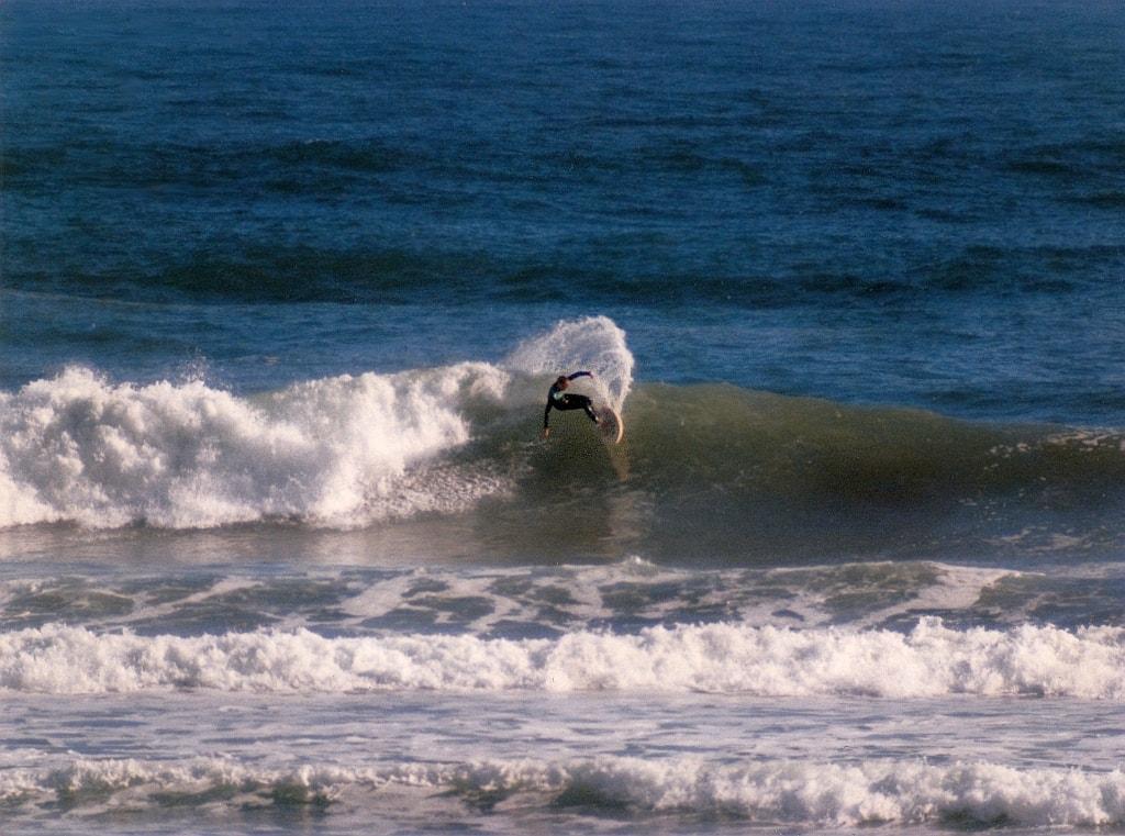 Surfer Shredding at Piha