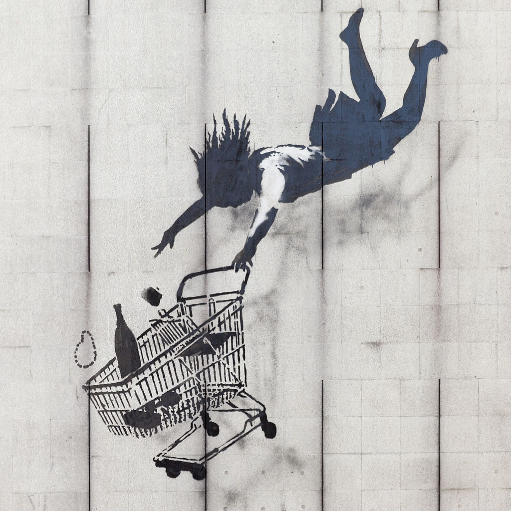 "Banksy, 'Shop Till You Drop,' 2011  | <a href=""https://commons.wikimedia.org/wiki/File:Shop_Until_You_Drop_by_Banksy.JPG"" target=""_blank"" rel=""noopener"">© QuentinUK/WikiCommons</a>"