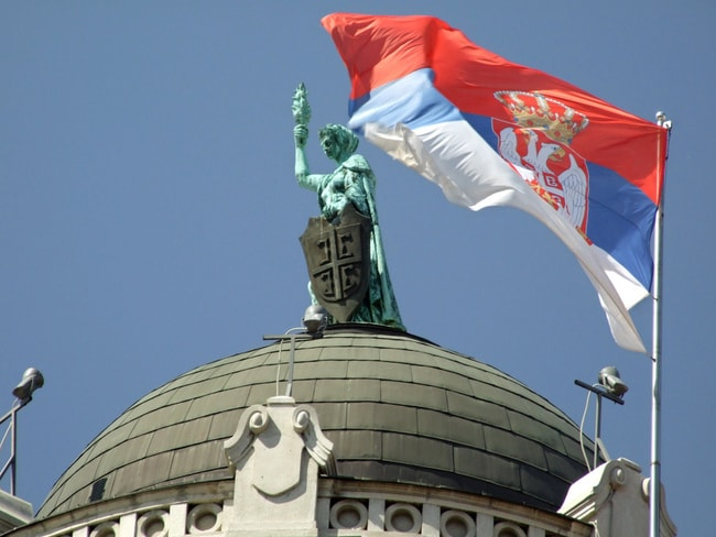 The Serbian flag flying proud | ©only_point_five/Flickr