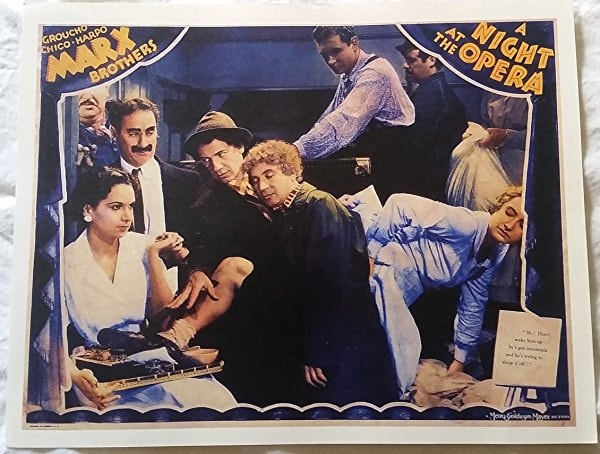This lobby card depicts the famous crowded cabin scene in 'A Night at the Opera' | © MGM