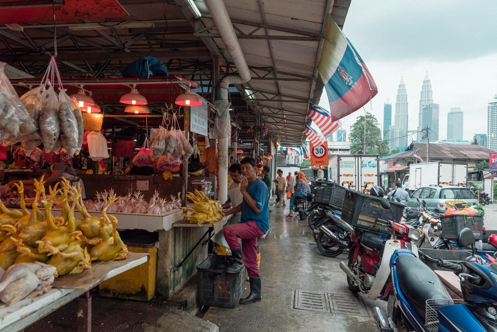 The Petronas towers can be seen from the wet market | Irene Navarro / © Culture Trip
