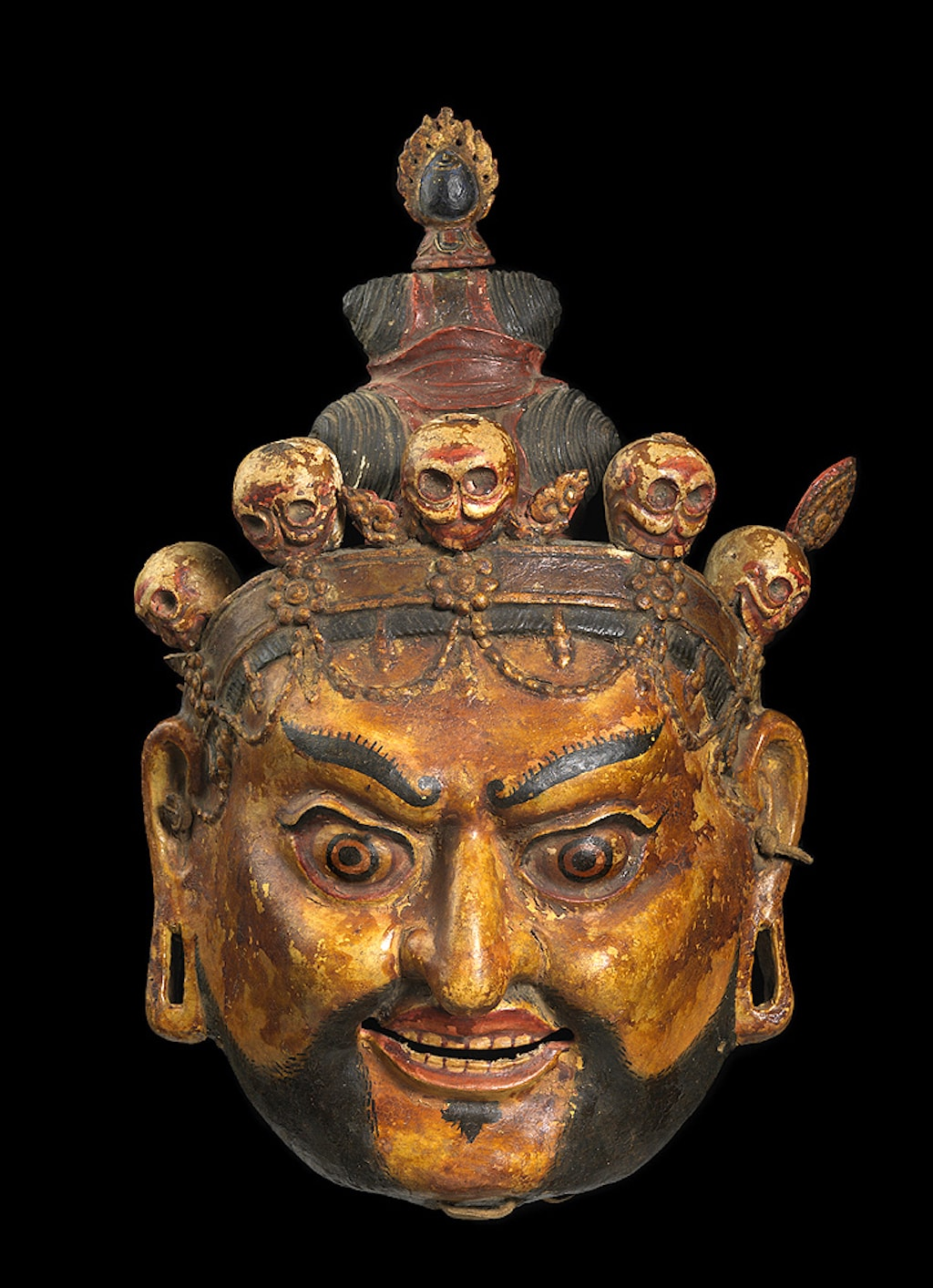 Ritual Dance Mask of Padmasambhava as Nyima Ozer (One of the Eight Manifestations of Guru Rinpoche). Bhutan; ca. 18th–19th century. Papier-mâché and pigment, leather. | Courtesy of the Bruce Miller Collection