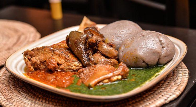 Amala atiewedu with fish and goatmeat stew