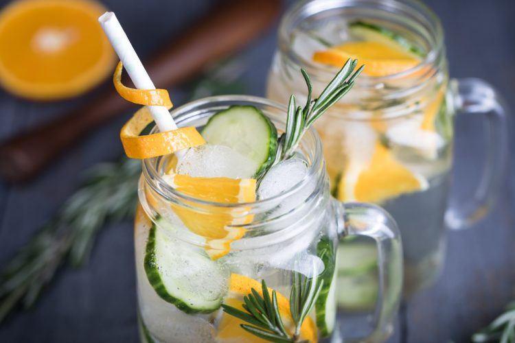 Homemade orange lemonade with cucumber and rosemary