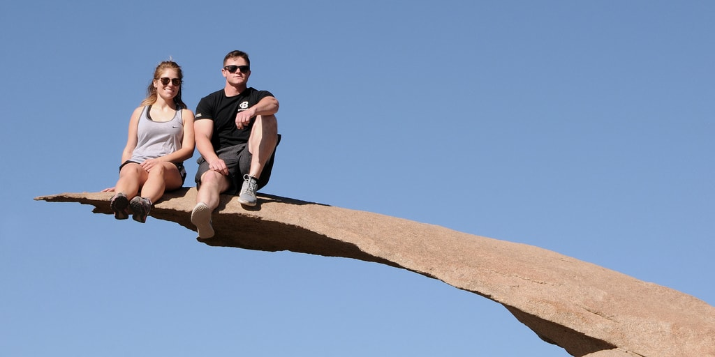 Hikers pose on Potato Chip Rock in San Diego.