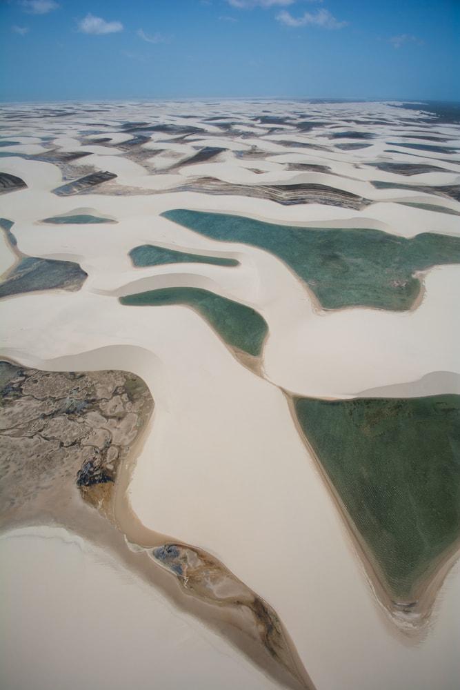 Natural rainwater pools in Lencois Maranhenses National Park, Maranhao, Brazil | © vitormarigo/Shutterstock