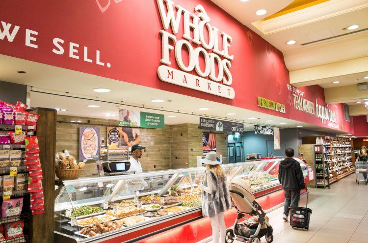 People shopping in Whole Foods Market in Kensington High Street, London.