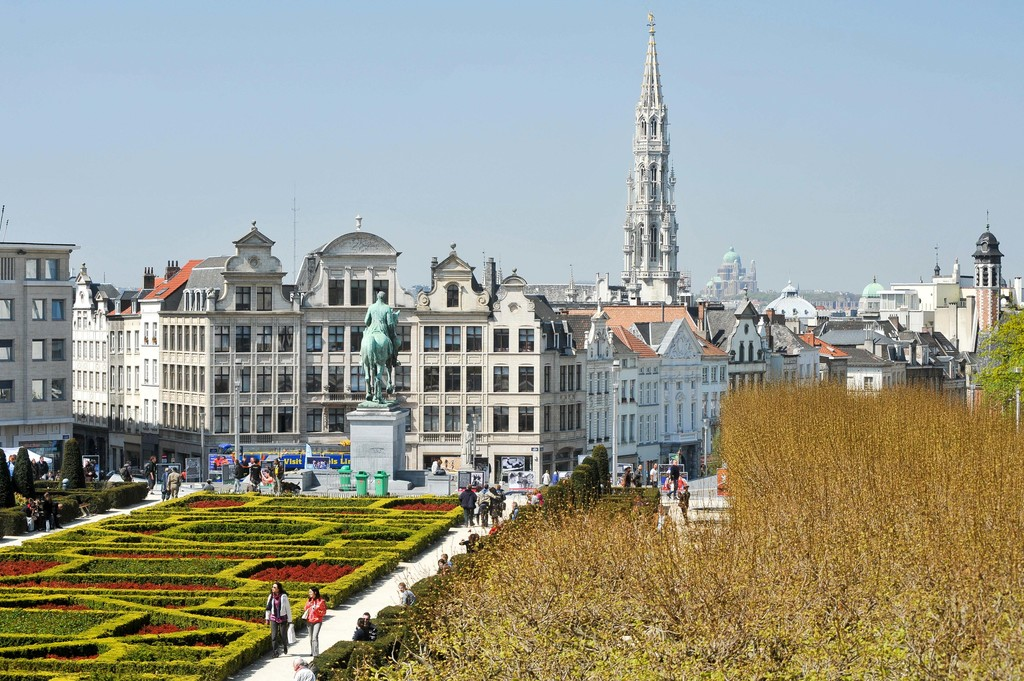 Garden and equestrian statue of King Albert I on Mont des Arts / Kunstberg, and Brussels Town Hall tower in Historic Centre of Brussels, Belgium. Apri