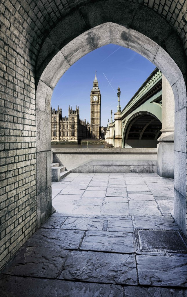 View of Big Ben through the pedestrian tunnel at sunset, London.