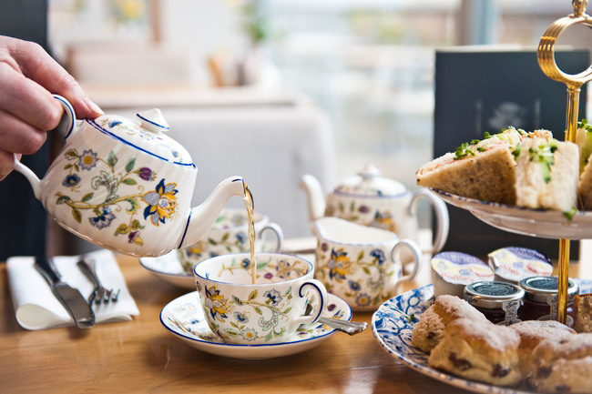 Typical English tea being poured from teapot