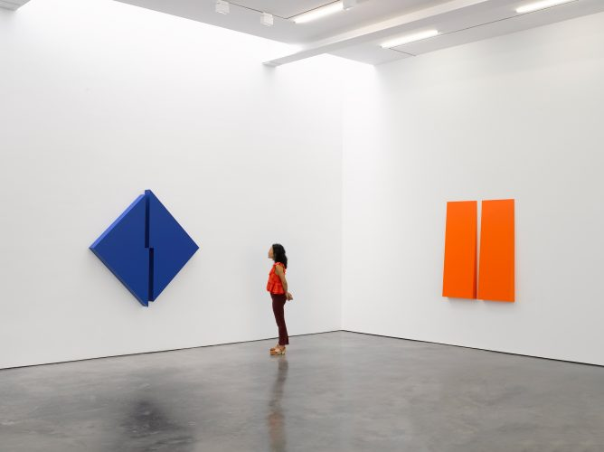 A woman ponders the Carmen Herrera installation at Lisson Gallery