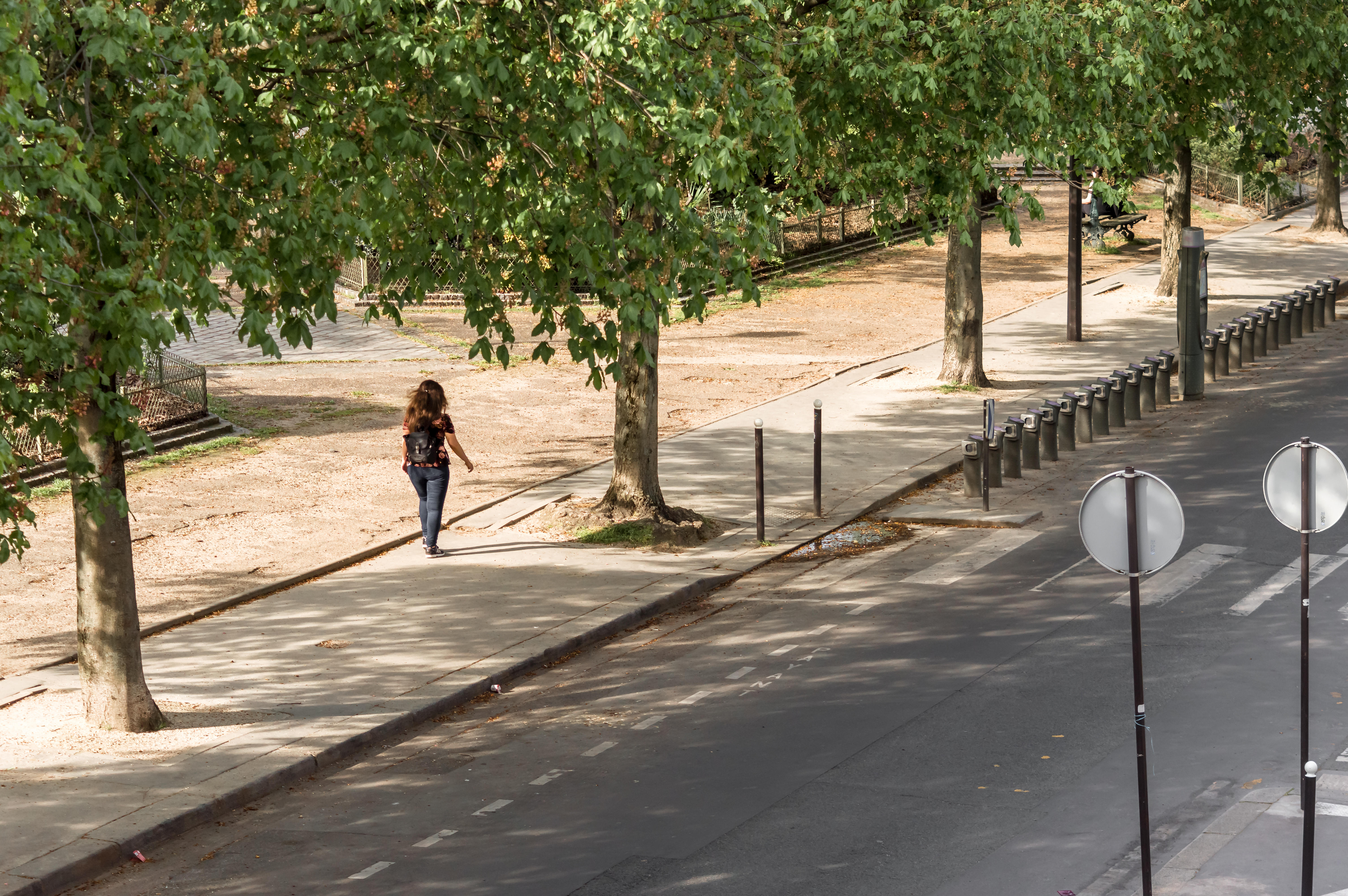Woman walking in the streets of Paris in the 2eme arrondissement