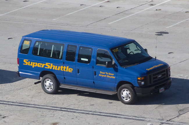 A Super Shuttle van parked at Miami International Airport