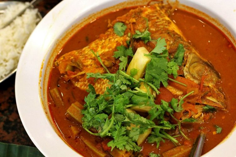Fish head curry is a must when having banana leaf meal