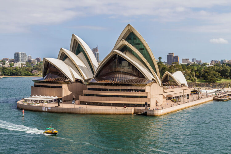 Water taxi passing Sydney Opera House.
