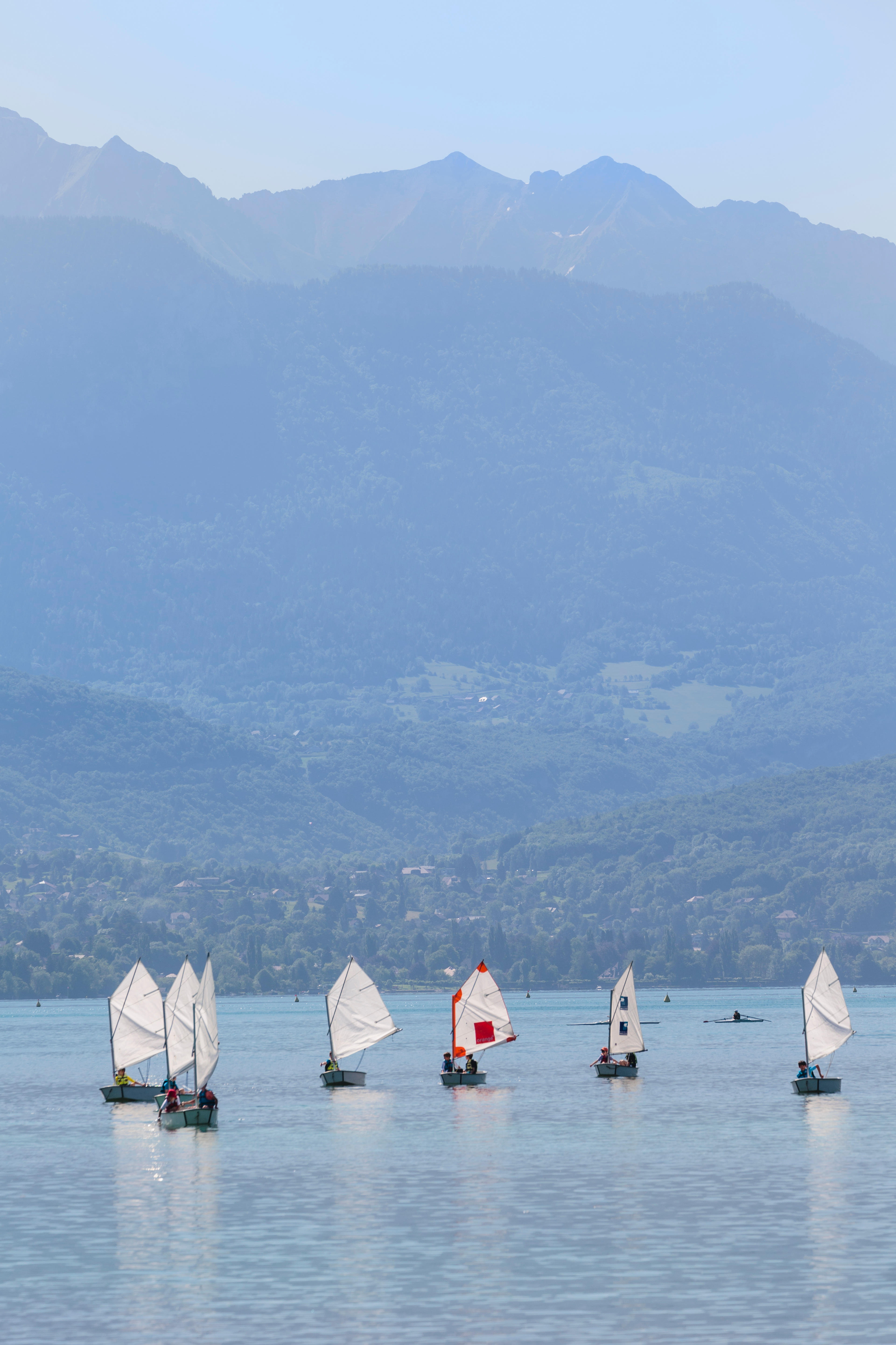 Annecy, Haute-Savoie department, Rhone-Alpes, France. Children sailing dinghies on Lake Annecy.